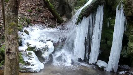 Waterfall in the National Park Slovak Karst, Haj in winter.