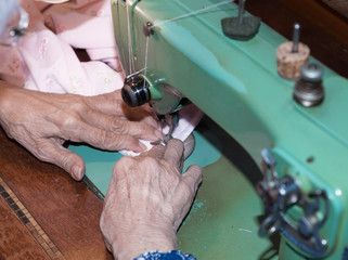 Person sewing machine