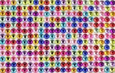 Colorful og shiny gems background.
