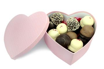Chocolate coated cream puffs in heart shape box