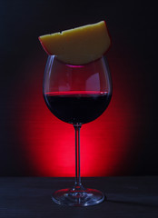 Glass of Red Wine with cheese on Lights Background