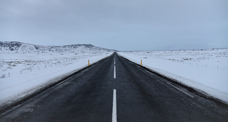 Road into snow-covered horizon