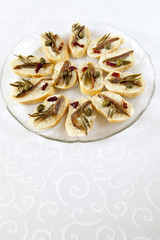 Canape selection with fish fillets, space for text