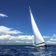 Yacht sails with beautiful cloudless sky. Luxury yacht.