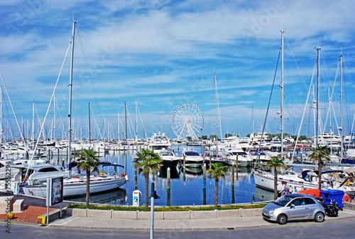 Leinwanddruck Bild touristic dock in Rimini, Italy