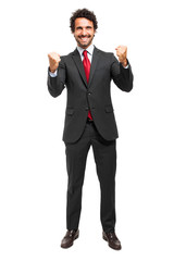 Businessman moving his arms in sign on victory