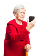 Upset old woman taking selfie or making video call on phone