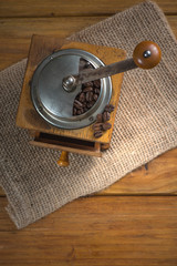 Old manual coffee grinder on wooden table