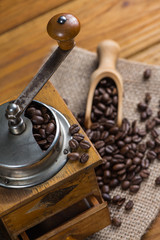Manual coffee grinder and roasted beans