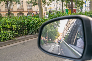 Driving in a big city. Rear mirror view