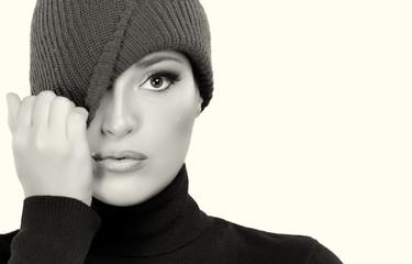 Beautiful Winter Girl in Wool Cap Cap. Monochrome Portrait