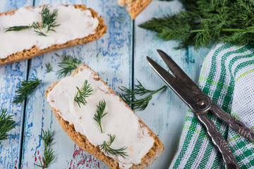 fresh dill with soft white cheese and wholegrain bread