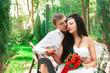 Bride and groom posing in amusement park
