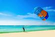 Thai man taking off with parasail on Phuket, Thailand - 75555295