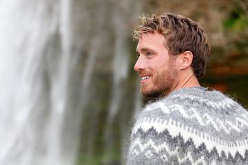 Handsome man in Icelandic sweater outdoor