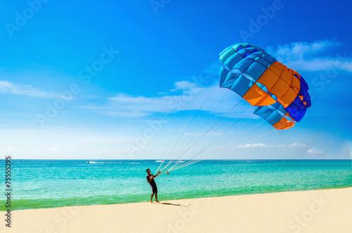 Fotobehang Water Motorsp. Thai man taking off with parasail on Phuket, Thailand