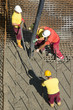 Construction workers casting foundations of hydro power plant - 75555433
