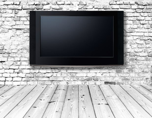 television set on an old wall