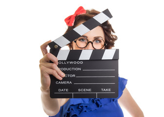 Young girl holding movie clapper board