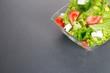 Green salat on gray or dark background