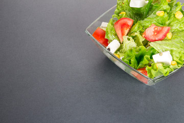 Green salat on gray or dark background