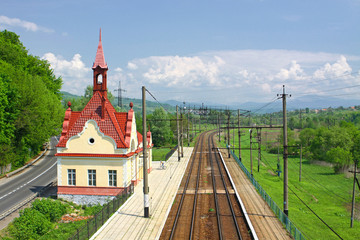 Railway tracks and small railway station in Carpathian mountains