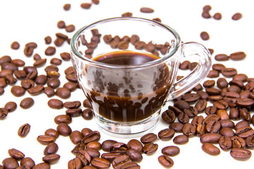 Cup of coffee and coffee beans on white background close up view