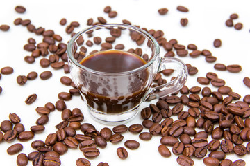 Cup of coffee and coffee beans on white background