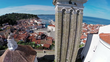 Flight and takeoff over old city Piran, aerial panoramic view
