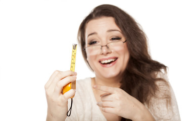women laughed at the size shown on the measuring tape