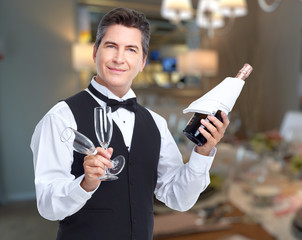 Waiter with wine and wineglasses
