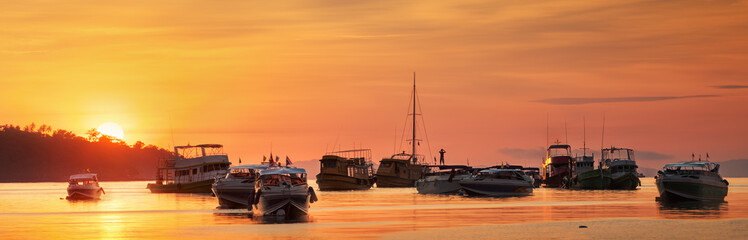 sunrise with colorful sky and boats