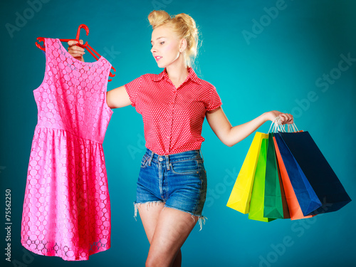 canvas print picture Pinup girl with shopping bags buying clothes dress