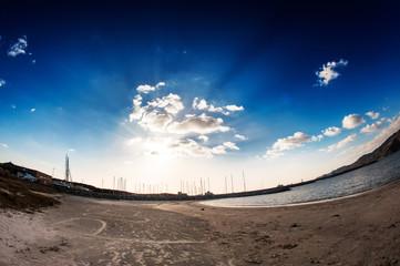 Deserted beach in backlight