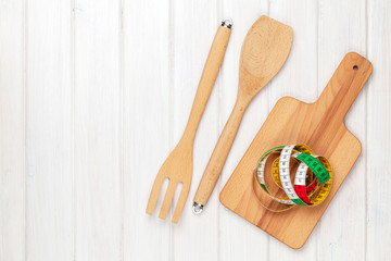 Healthy food and kitchen utensils