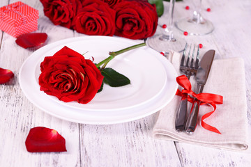 Beautiful romantic table setting with red roses close-up