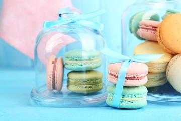 Gentle colorful macaroons in glass jars