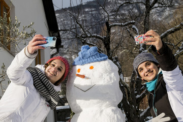 selfie with girls and snow man