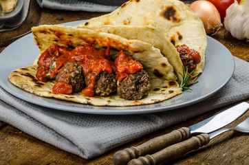 Indian naan with meatballs and tomato sauce