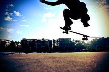 skateboarding legs jump in the city