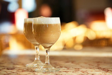 spanish coffee latte in tall glasses with morning sunny backgrou