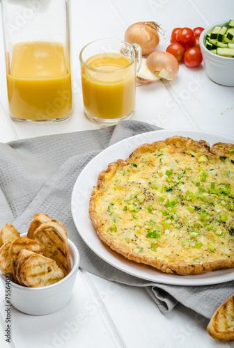 Leinwanddruck Bild Omelette with zucchini and mozzarella cheese, scallions