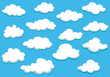 Cartoon clouds set on blue sky background - 75564684
