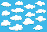 Cartoon clouds set on blue sky background - 75564684