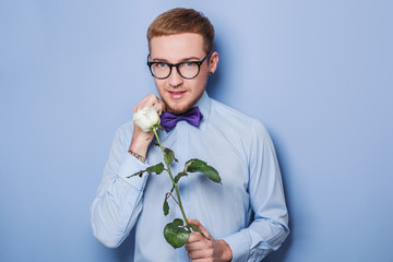 Cute young man with rose. Date, birthday, Valentine