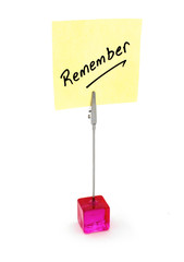Remember text on a yellow note paper.