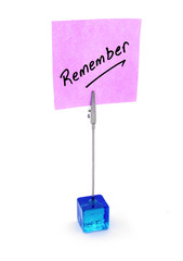 Remember text on a pink note paper