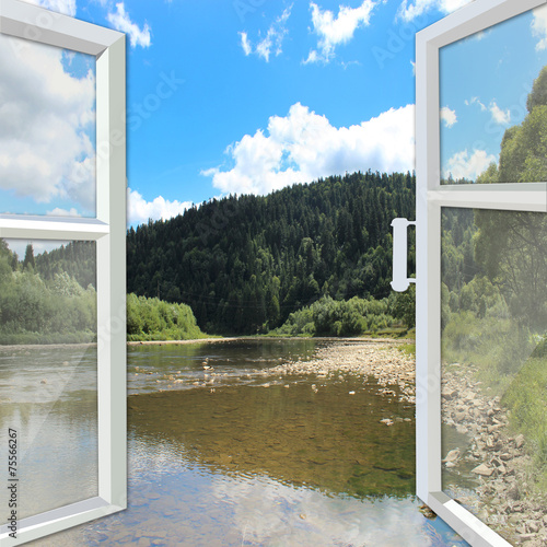 window opened to the river and mountains - 75566267