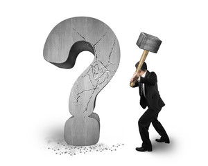 businessman holding hammer cracked question mark isolated on whi