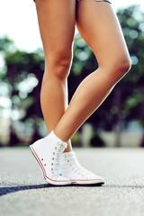 Legs in sneakers